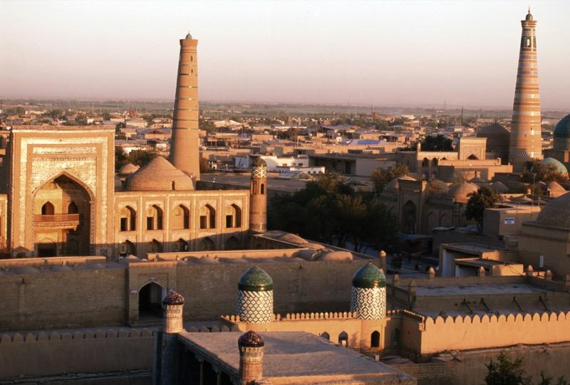 The last rays of the sun as it sets in Old Town Khiva, Uzbekistan. Photo credit: Peter Guttman