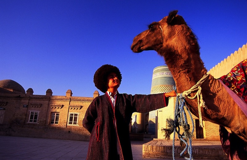 A local offers a camel ride in Old Town Khiva, Uzbekistan. Photo credit: Peter Guttman