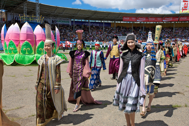 Young women parade in Mongolian costumes at Naadam Festival opening ceremonies in Ulaanbaatar. Photo credit: Helge Pedersen