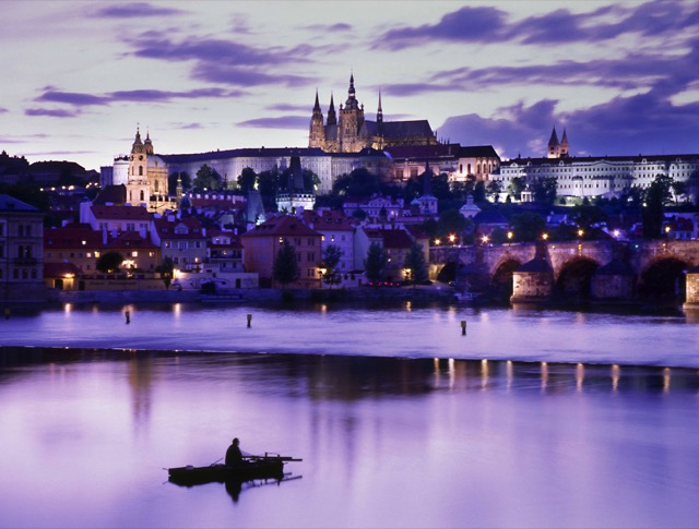 Prague's regal old city and towering castle above the Vltava are beautifully lit at sunset. Photo credit: Czech Tourist Authority