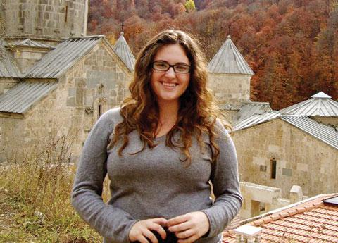 Amy enjoying the autumn colors at Haghartshin Monastery in Armenia. Photo credit: Amy Stidger