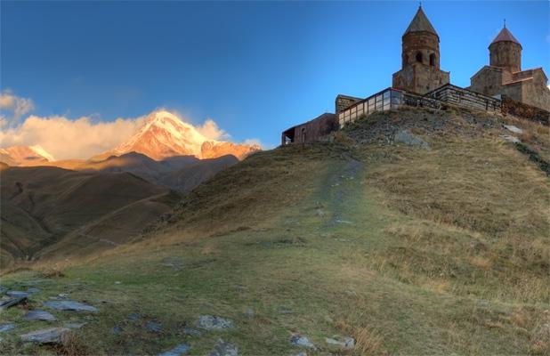 Third largest in Georgia, Mount Kazbek towers over the 14th century church of Tsminda Sameba. Photo credit: James Carnehan