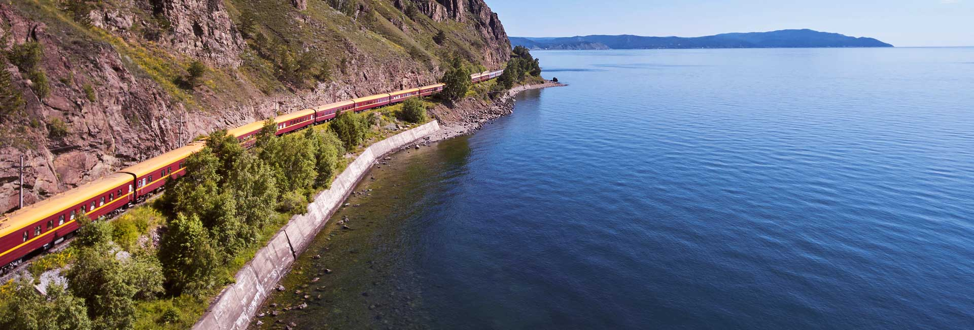 The Tsar's Gold Train rides the shores of Lake Baikal (Siberia, Russia). Photo credit: Ross Hillier