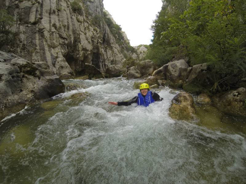 MIR Private Journeys Specialist Lisa Peterson goes canyoning in the Cetina River near Split, Croatia. Photo credit: Lisa Peterson