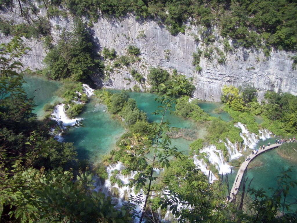 Plitvice National Park is a series of 16 stunning interlinked lakes amid forested mountains in Croatia. Photo credit: Lisa Peterson
