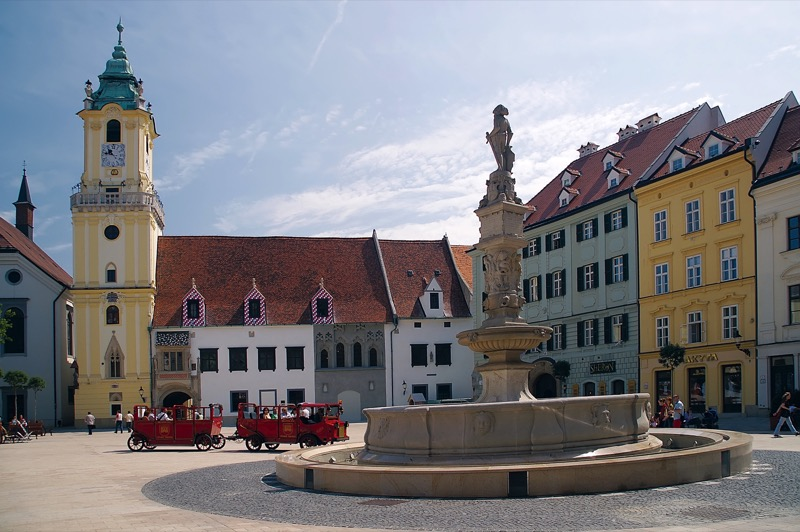 Old Town Hall and the elegant Maximilian Fountain flank Hlavné Námestie Square in Bratislava, Slovakia. Photo credit: Jan Lacika