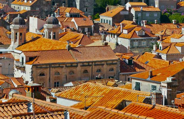 Newer tiles (yellow-orange) attempt to blend in with older, original terracotta red tiles that distinguish Dubrovnik's renowned roofs. Photo credit: Martin Klimenta