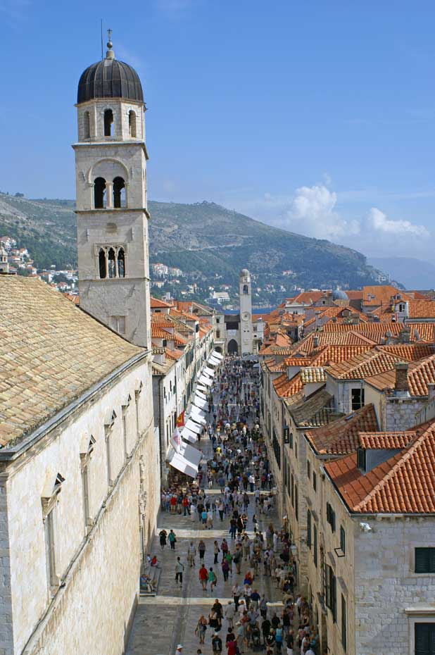 Stradun is Dubrovnik's main street – wide by the Old Town's standards – with bell towers at each end of the quarter-mile pedestrian walkway. Photo credit: Douglas Grimes