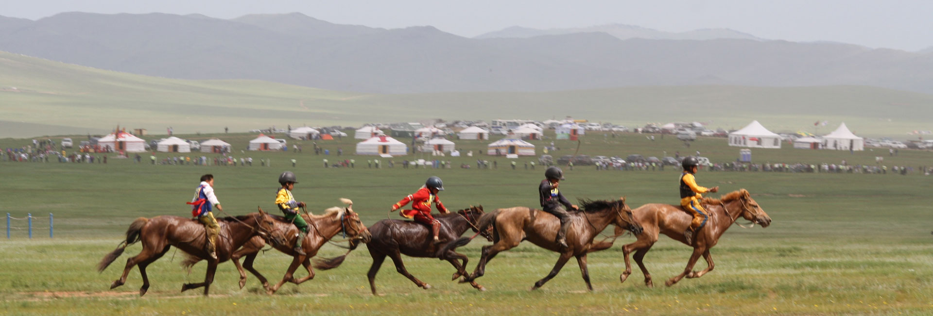 Horse racing games at Mongolia's Naadam Festival. Photo credit: Devin Connolly
