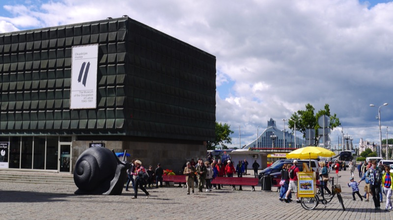 The Museum of Occupation stands in stark, sobering contrast to the colorful architecture of Riga's Old Town Square. Photo credit: Martin Klimenta