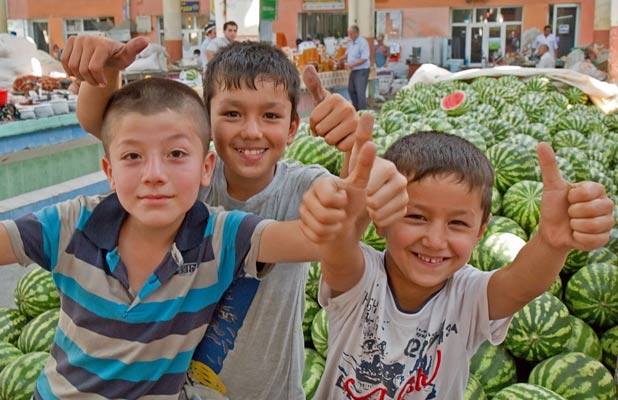 Young boys offer a warm welcome to Khujand's Panjshanbe Bazaar.  Photo credit: Richard Fejfar