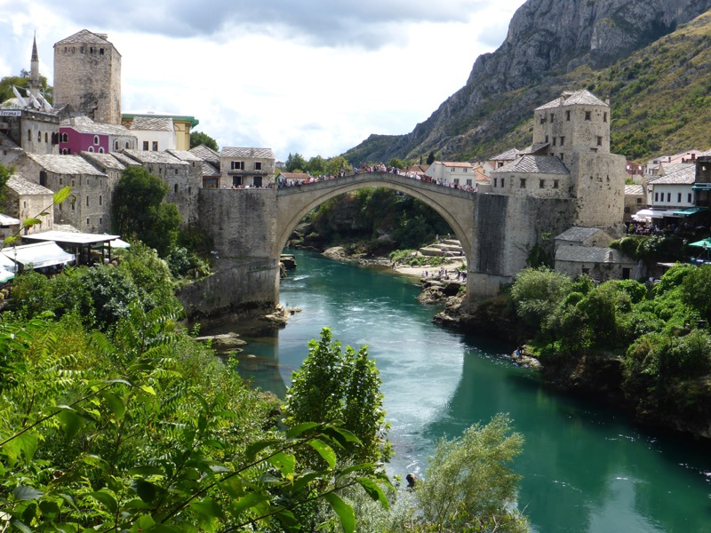 Mostar's Old Bridge connects the two parts of town, divided by the Neretva River. Photo credit: Chris Lira