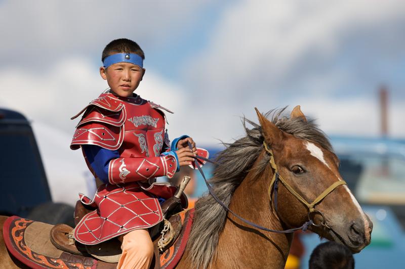 Young rider at Naadam Festival in Ulaanbaatar, Mongolia. Photo credit: Helge Pedersen