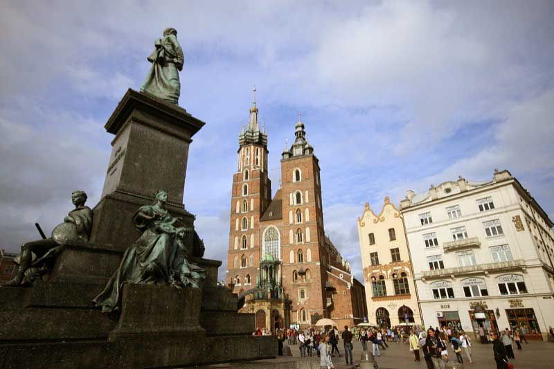 The largest remaining medieval town square in Europe, Rynek Glowny in Krakow. Photo credit: Polish National Tourist Board