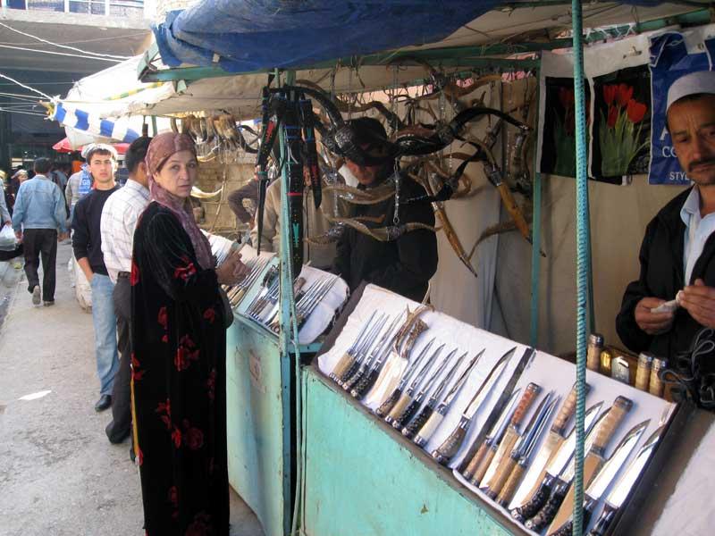 Knife sellers at Istaravshan Market. Photo credit: Jake Smith