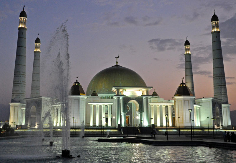The Kipchak Mosque glows at sunset in Ashgabat, Turkmenistan