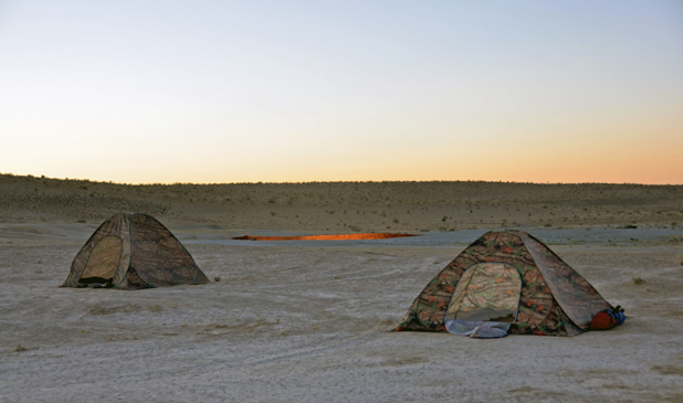 The campfire never goes out for tenters at Turkmenistan's Darvaza Gas Crater. Photo credit: Russ Cmolik & Ellen Cmolik