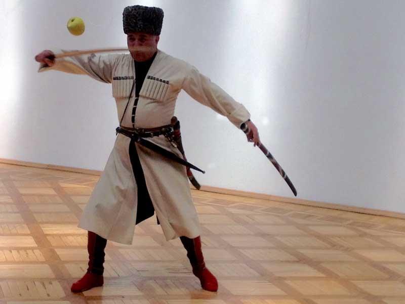 A Circassian man demonstrates his skill with the shashka in Kabardino-Balkharia. Photo credit: Michel Behar