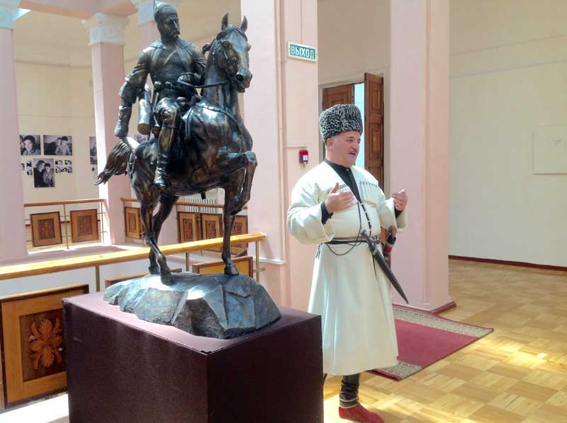 Traditionally-dressed Circassian man talks about the customs of his culture at the museum. Photo credit: Michel Behar