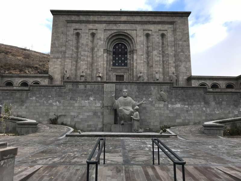 A statue of the Matenadaran's namesake — St. Mesrop Mashtots, the inventor of the Armenian alphabet — stands just in front of the building complex. Photo credit: Jessica Clark