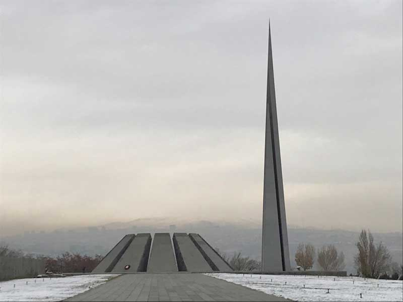 The memorial is flanked by a 44-m stone pillar, a symbol of Armenia's rebirth. Photo credit: Jessica Clark