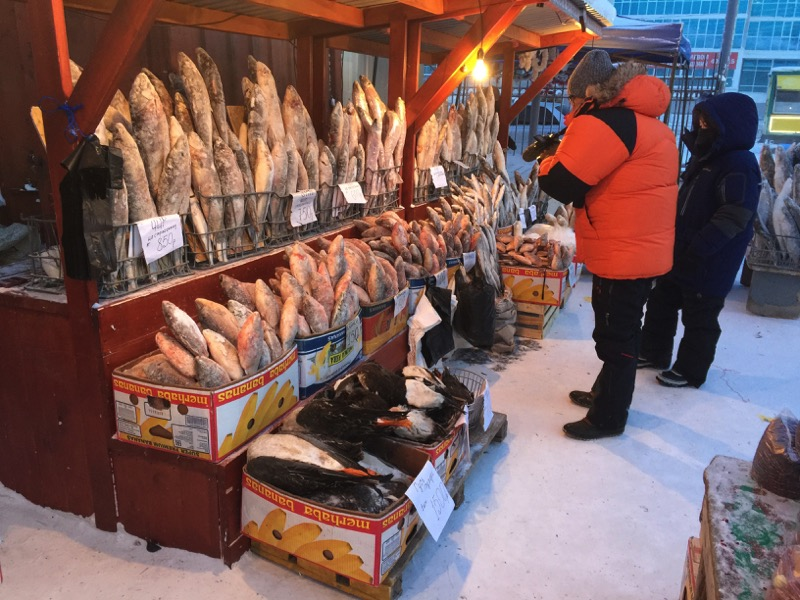 Winter fashion on display at a Yakutsk frozen fish market