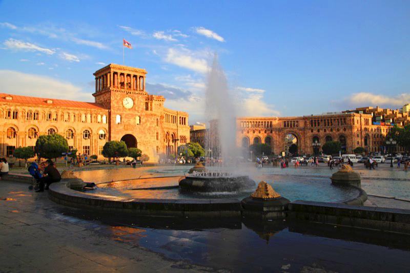 Dusk sets in on Yerevan's Republic Square (Armenia). Photo credit: Ann Schneider