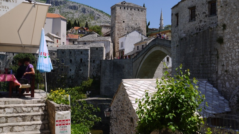 View of Mostar Bridge from an outdoor cafe. Photo credit: Martin Klimenta
