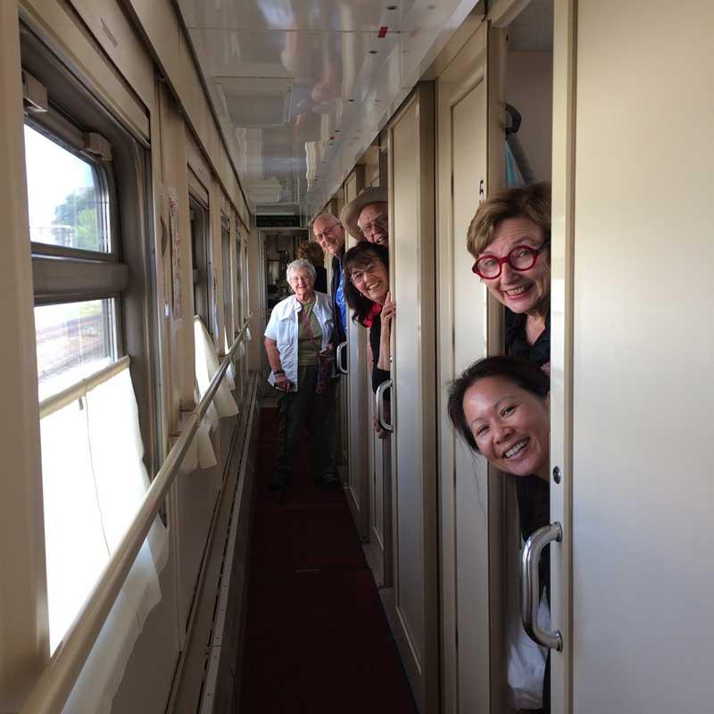 Travelers peeking from their cabins into the corridor. Photo credit: Anna Ivanova