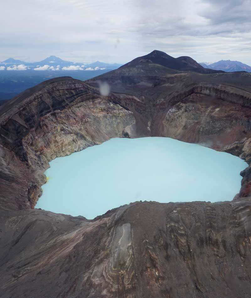 Turquoise lake in a volcano crater en route to Valley of the Geysers, Kamchatka. Photo credit: Jake Smith