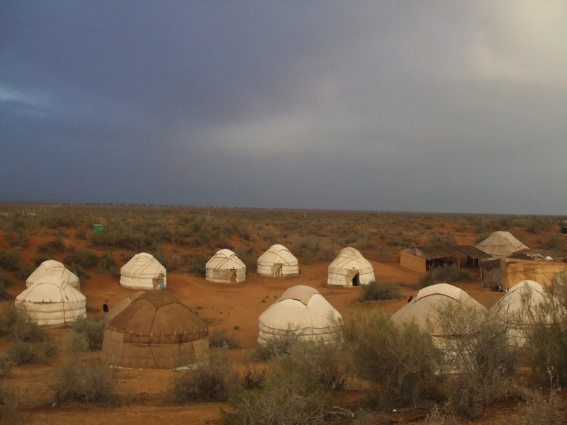 A traditional yurt camp out in the red sands of the Kyzyl Kum Desert. Photo credit: Andrei Baev