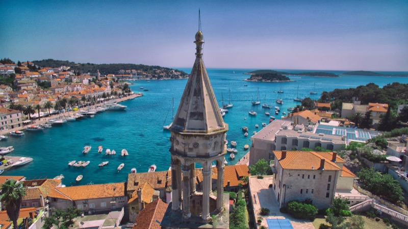 A panoramic view of Hvar and its turquoise harbor. Photo credit: Croatian National Tourist Board