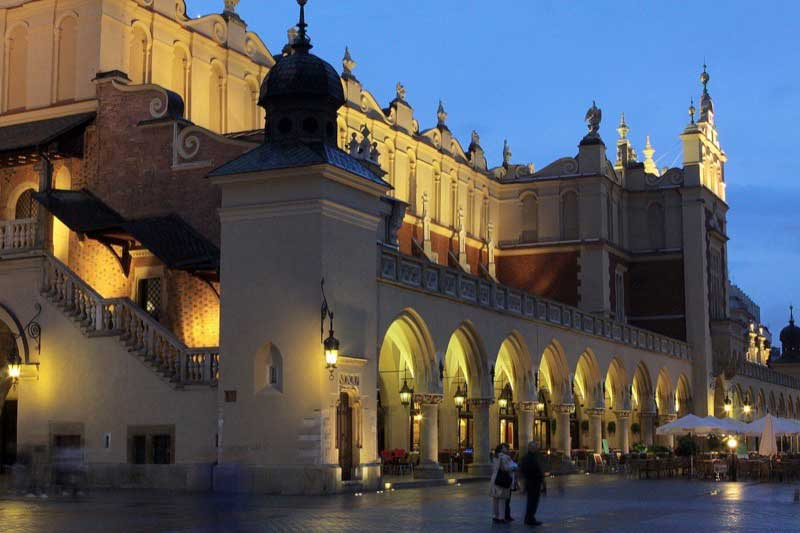 The Renaissance Cloth Hall glows in Rynek Glowny, Krakow. Photo credit: Polish National Tourist Board