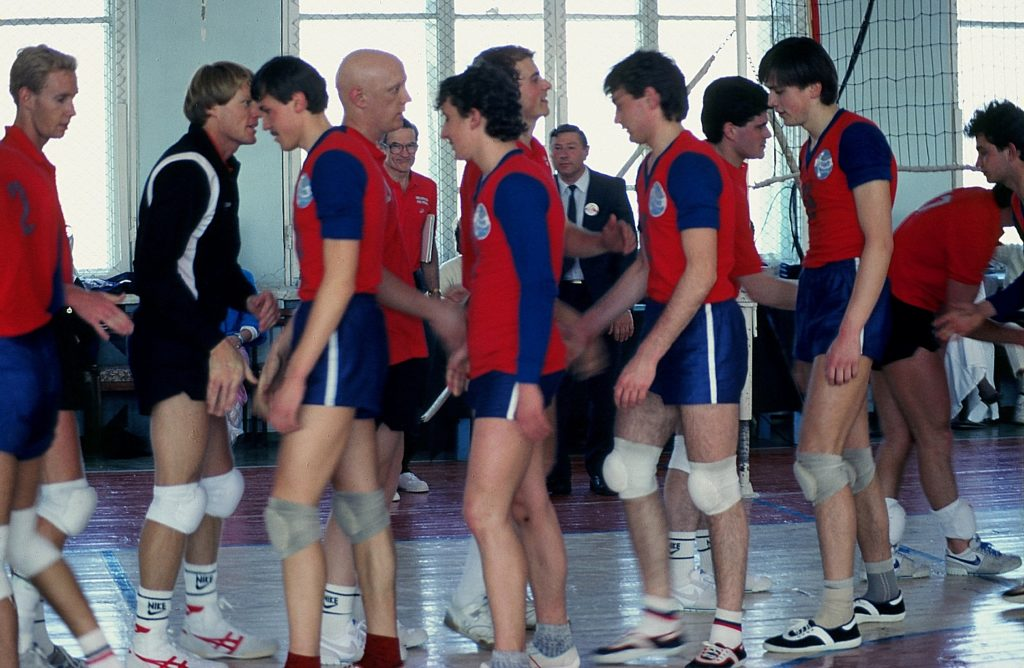 Douglas Grimes' (second from right) childhood dream came true, playing Soviet volleyball champs throughout the U.S.S.R. in 1987 (Douglas' dad is in the center near the window, wearing glasses). Photo credit: Douglas Grimes
