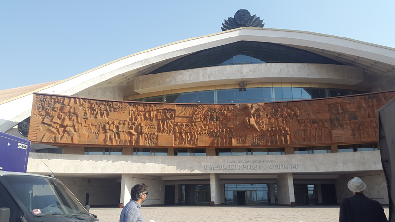 Yerevan is dotted with old Soviet buildings and monuments, like the Karen Demirchyan Sports and Concerts Complex. Photo credit: Anya von Bremzen