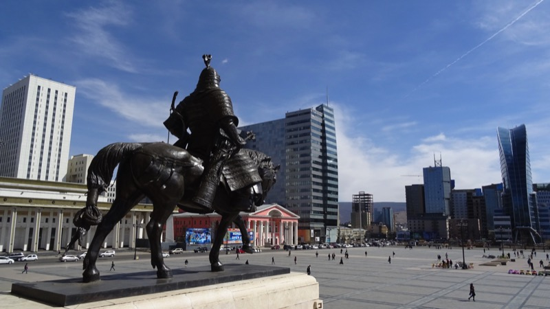 A statue of a Mongol warrior stands guard outside the Parliament Building in Sukhbaatar Square, Ulaanbaatar. Photo credit: Vladimir Kvashnin