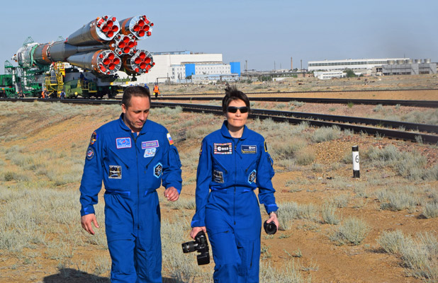 Backup crew cosmonauts finish shooting photos of 'their' Soyuz rocket. Photo credit: Douglas Grimes