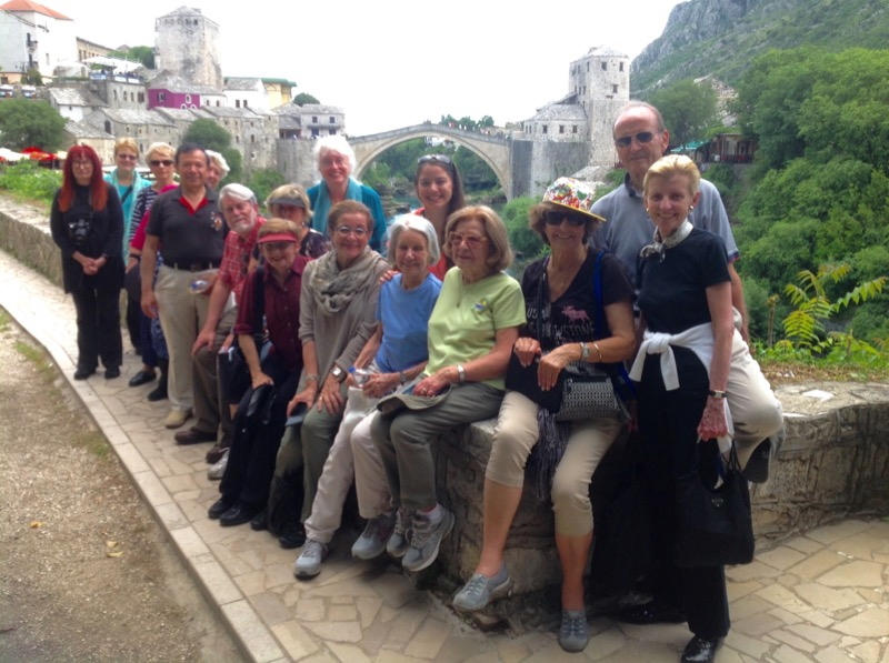 Patricia and her fellow travelers pose in front of Mostar Bridge in Bosnia & Herzegovina. Photo credit: Michel Behar