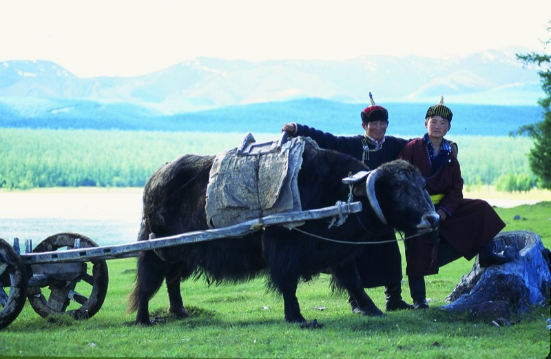 Locals pause for a photo op at Lake Hovsgol, Mongolia. Photo credit: Peter Guttman