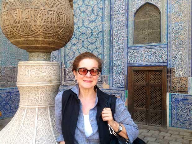 Patricia in her favorite spot on the trip to Central Asia – Khiva, Uzbekistan. Photo credit: Michel Behar
