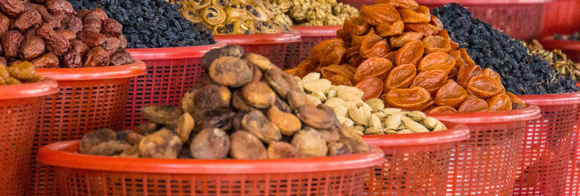 Dried fruit and nuts at a market in Samarkand. Photo credit: Andra Artemova