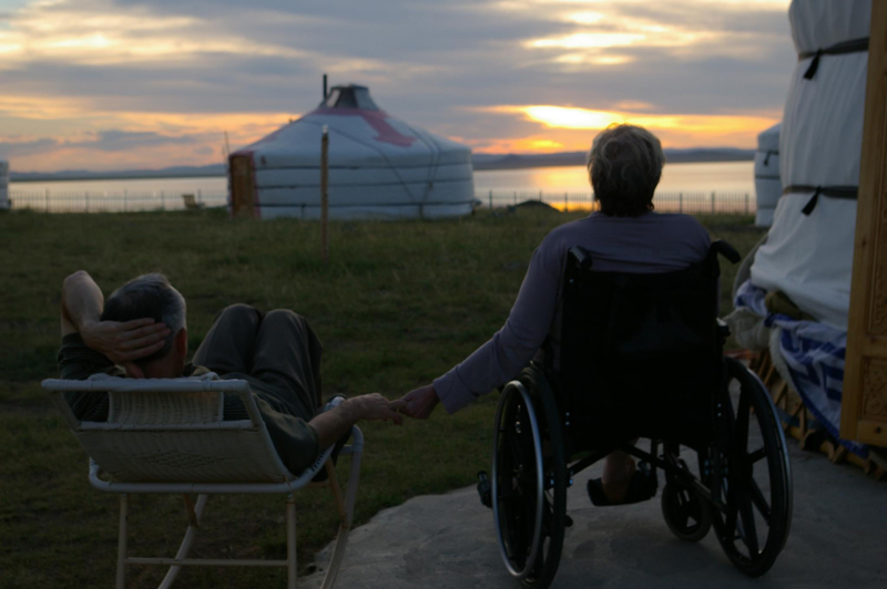 Author Jack Weatherford, pictured with his late wife, enjoy a Mongolian sunset. Photo credit: Susan Murphy