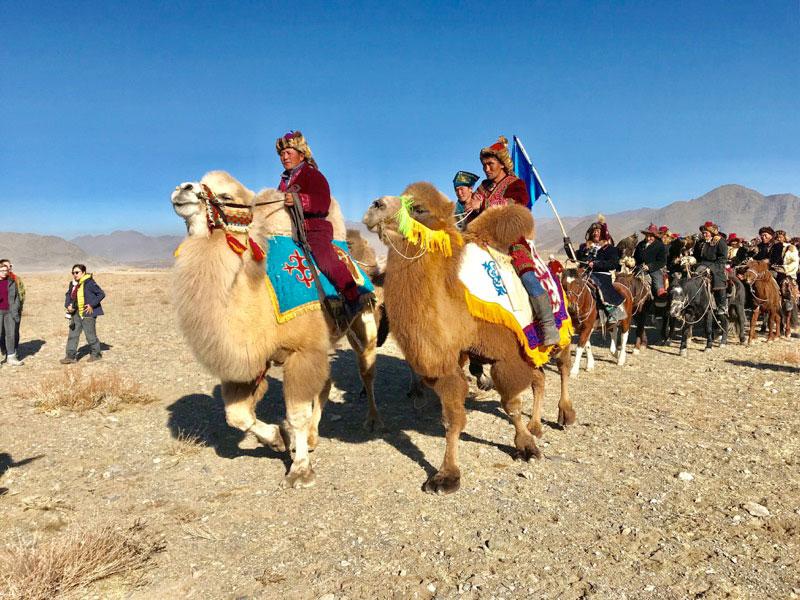 A parade of eagle hunters, kicking off Mongolia's Golden Eagle Festival. Photo: Michel Behar