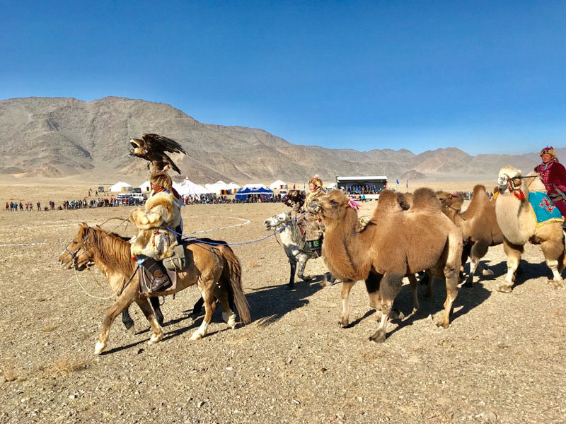Another snapshot of a parade of eagle hunters, marking the start of Mongolia's Golden Eagle Festival. Photo: Michel Behar