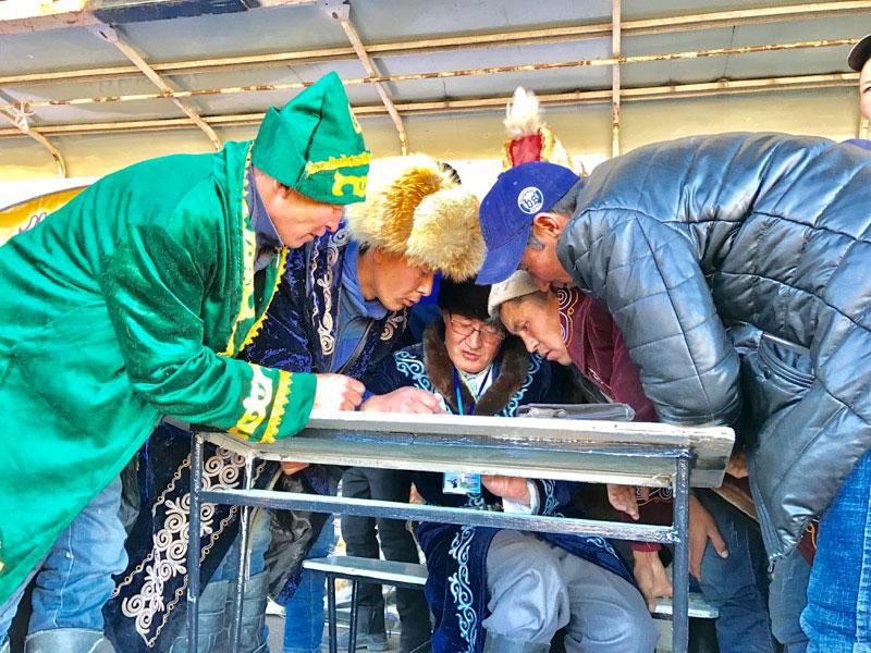 Tabulating the scores at Mongolia's Golden Eagle Festival. Photo: Michel Behar