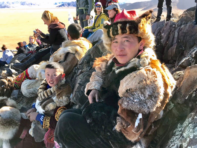 Meeting and chatting with eagle hunters and their families at Mongolia's Golden Eagle Festival. Photo: Michel Behar