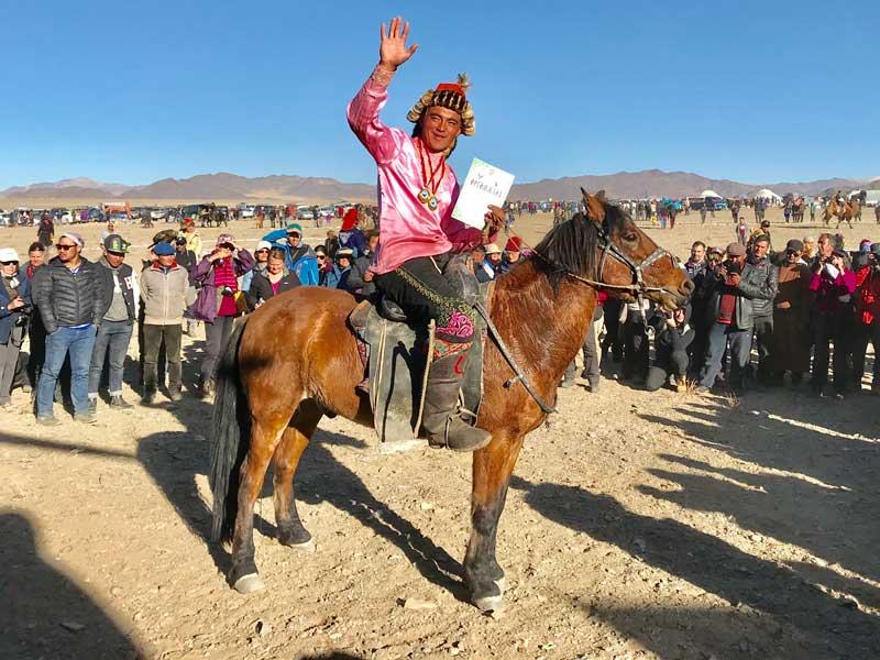 A proud winner at the Golden Eagle festival in Mongolia. Photo: Michel Behar