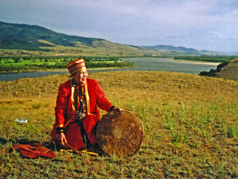 A Buryat shaman performs a sacred ritual in Siberia. Photo credit: Michel Behar