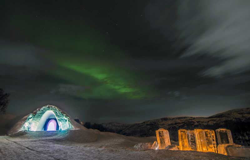 Northern Lights over the Snow Hotel. Photo credit: Kirkenes Snow Hotel / Nevra Pictures