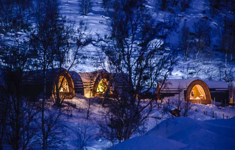 Guests can choose to stay in heated cabins modeled after the traditional dwellings of the Sami people. Photo credit: Kirkenes Snow Hotel / Nevra Pictures